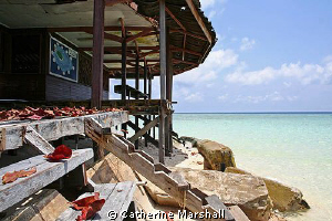 Abandoned dive lodge, Sipadan.  Canon 350D. by Catherine Marshall