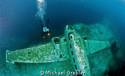 Diver and plane wreck in Morrison's Quarry. Photo taken u... by Michael Grebler
