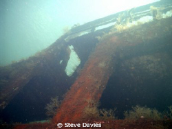Wreck at Nea Kameni island in the caldera at Santorini by Steve Davies