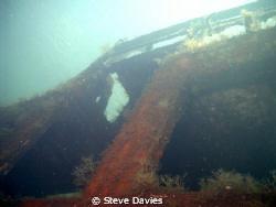 Wreck at Nea Kameni island in the caldera at Santorini by Steve Davies