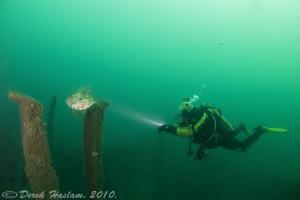 Chris on the Persier wreck. Plymouth. D3, 16mm. by Derek Haslam