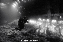 Inside the hull of the Tabarka in Scapa Flow.  The diver ... by Pete Devereux