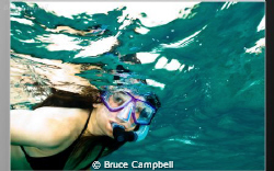 Snorkeling before committing to the dive. by Bruce Campbell