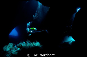Divers enter 'Swiss Cheese' Dive site in Menorca by Karl Marchant