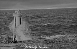 Bonaire's Lacre Punt Lighthouse at high tide - July 2010 by George Smorse