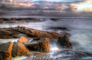 Stormy sunset on Noordhoek beach. Long exposure Hdr by Tony Makin