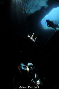 Cave of light again, this time showing the underwater lig... by Karl Marchant