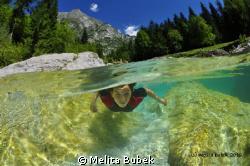 Mi daughter Maja swimming in river Soca...Nauticam housin... by Melita Bubek