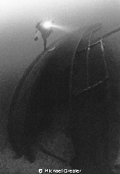 """A diver descends onto the stern of the """"Keystorm"""" in the ... by Michael Grebler"""