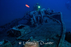 Divers on nazi wreck by Vittorio Durante