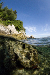 Split level of a Croatian rocky shore line.  Natural ligh... by Paul Colley