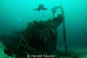 "Diver over the stern of ""Hilda"" sunk  in 1875, now restin... by Harald Fauske"