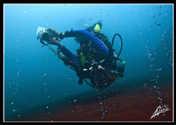 diving near an active VOLCANO! streams of warm bubbles co... by Adriano Trapani