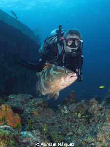 Evelio and the nassau grouper by Abimael Márquez