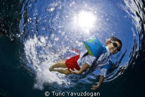 A big Splash..... into the ocean. by Tunc Yavuzdogan