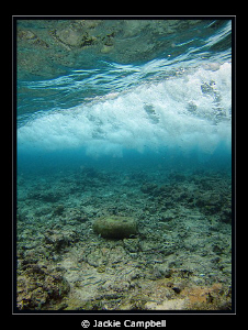 Wave breaking over a shallow reef. Canon S90, manual set... by Jackie Campbell