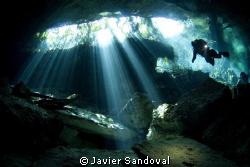 Diver in cenote by Javier Sandoval