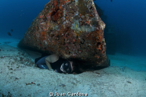 A real diver even when sleeps dreams himself at the botto... by Juan Cardona