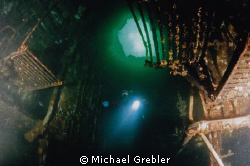 Descending into the engine room of the Wolfe Islander nea... by Michael Grebler