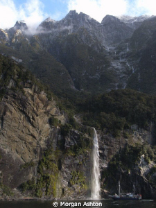 Milford Sound waterfall -from the clouds to the sea. Some... by Morgan Ashton