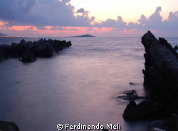 A beautiful sunset in the Mediterranean sea. by Ferdinando Meli