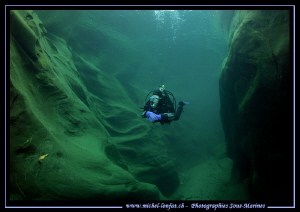 River diving. My wife Caroline going up the Verzasca... Q... by Michel Lonfat