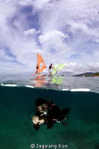 Windsurfing and Diving by Jagwang Koo