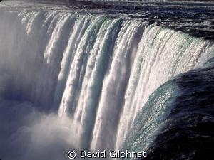 At the brink. Niagara Falls, Ontario. by David Gilchrist
