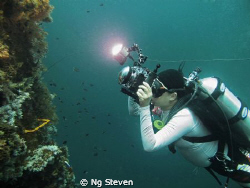 Diver taking shots at The Cement Wreck by Ng Steven