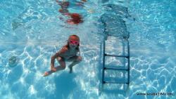 Little girl in pool... by Tim Ho