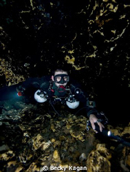 Cave diver sidemounting inside of Florida cave. by Becky Kagan