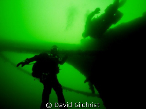 Divers at the bow of Great Lakes sailing vessel- George A... by David Gilchrist