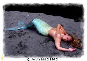 washed ashore  Mermaid Angela on a quiet beach somewhere. by Arun Madisetti