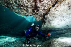 My dive buddy poking his head into a cave in FL with sunr... by Becky Kagan