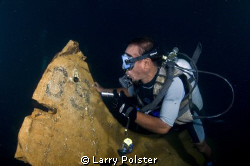 Tail section of Japanese Zero in the hold of sunken freig... by Larry Polster