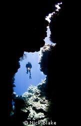 Enjoying the caves at Jackfish Alley. Nikon D300 & 10.5m... by Nick Blake