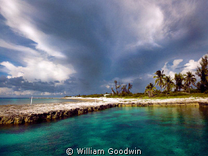 Storm approaching the Pool at Bucaneer, Cayman Brac by William Goodwin