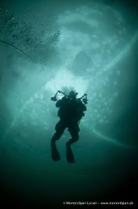 Under the ice. by Morten Bjorn Larsen