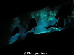 Shadow. The shadow of divers in cenote Chacmool by Philippe Duval
