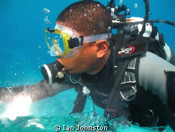 Dive guide taken from inside a personal minisub in Maurit... by Ian Johnston