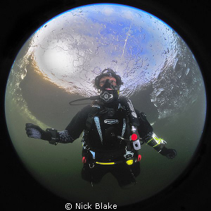 Our world. A dive under ice at Wraysbury Lake. by Nick Blake
