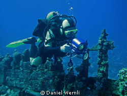 Dive buddy Dany with only his wreck movie in mind :-) by Daniel Wernli