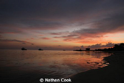 After the sunset on the beach of Little Cayman Dive resort by Nathan Cook