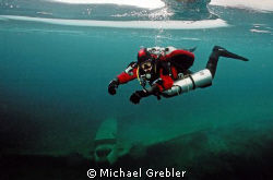 Tech diver under the ice in Morrison's Quarry, Quebec. Ni... by Michael Grebler