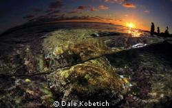 half above half below.....dreamy sunset in Laguna Beach..... by Dale Kobetich