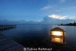 Clouds over the mainland at sunset, Laguna Beach, Utila. ... by Tobias Reitmayr