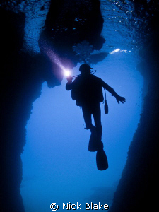 A dive in the Gozo caves. by Nick Blake
