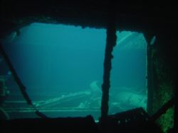 Looking from Hold 1 into Hold 2 SS Thistlegorm....was goi... by Harvey Page