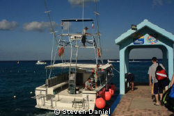 Divers Loading up on Paradise Divers Boat by Steven Daniel
