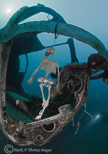 Skeleton crew. Helicopter sunk in inland quarry. by Mark Thomas